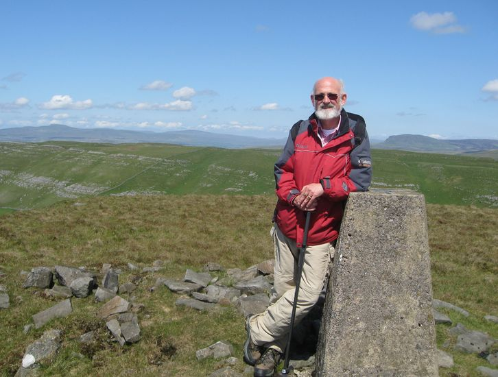 Photo057 John on Rye Loaf Hill w Ingleborough and Pen-y-Ghent background