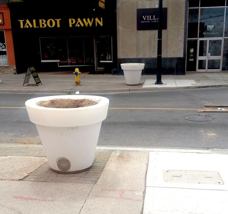 Empty street planters on Dundas