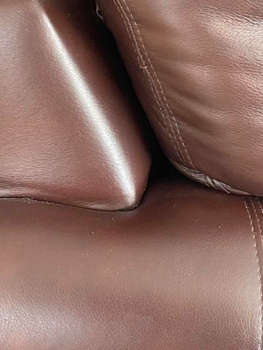 May be an image of saddle-stitched leather